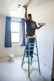 Picture of our crew members painting the ceiling of our customer in Desmoines, IA